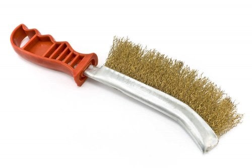 A metal wire brush can remove paint from metals.