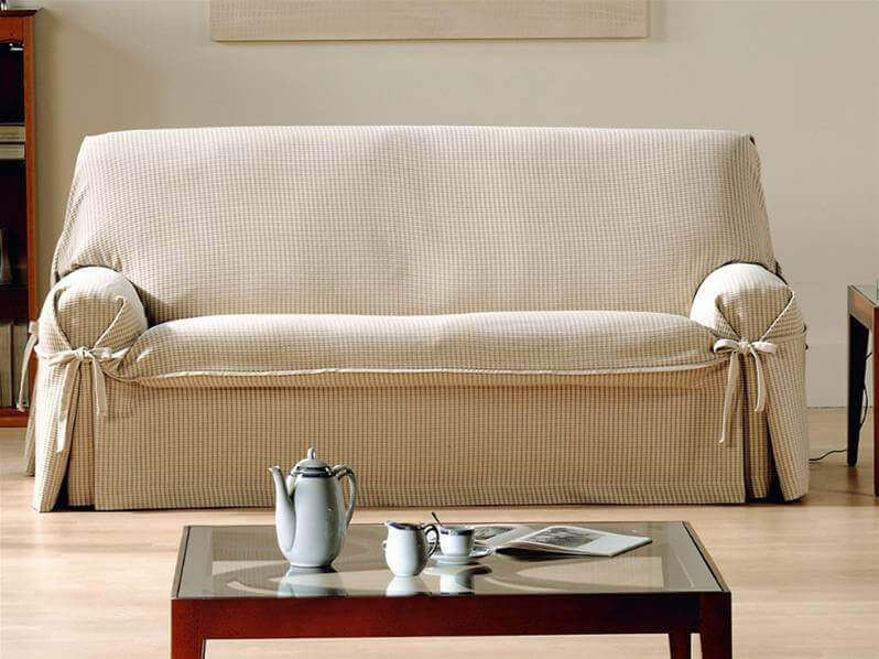 An adjustable beige sofa cover