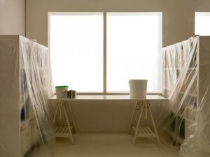 Drop cloths or plastic sheeting are essential for protecting both floors and furniture.