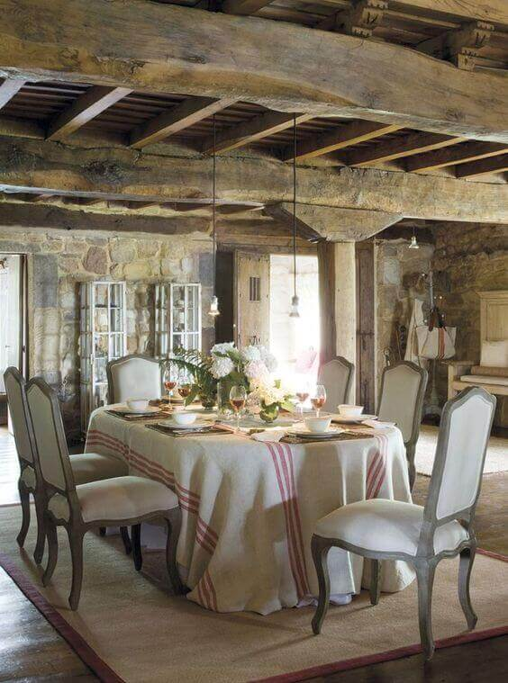 Thick oak beams, chairs with padded seats and backs and natural stone are keys to the French provincial style
