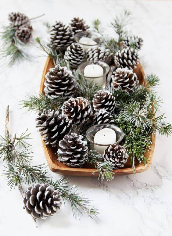 Autumn themed table decoration using pine cones