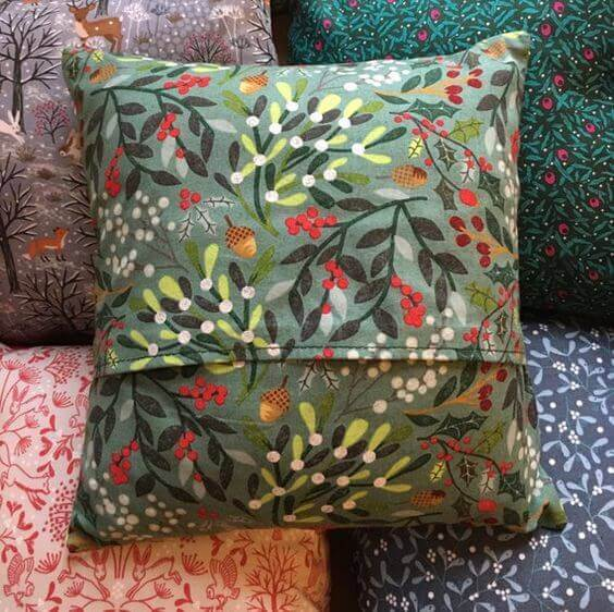 Fabric print cushion covers using leaves as a pattern.