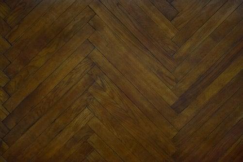A dark colored parquet floor.