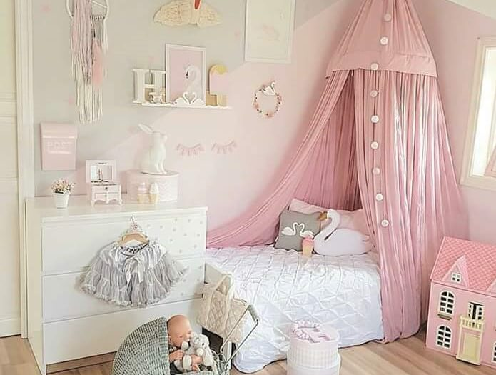 A pink canopy draws the eye in a child's bedroom