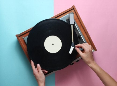 A person playing a record on a record player.