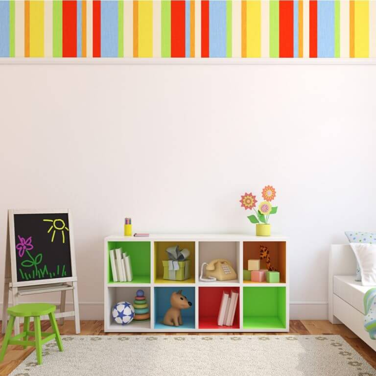A colorful striped wall in a child's bedroom