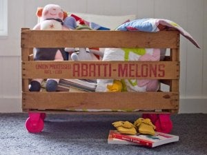 Using fruit crates as toy boxes.