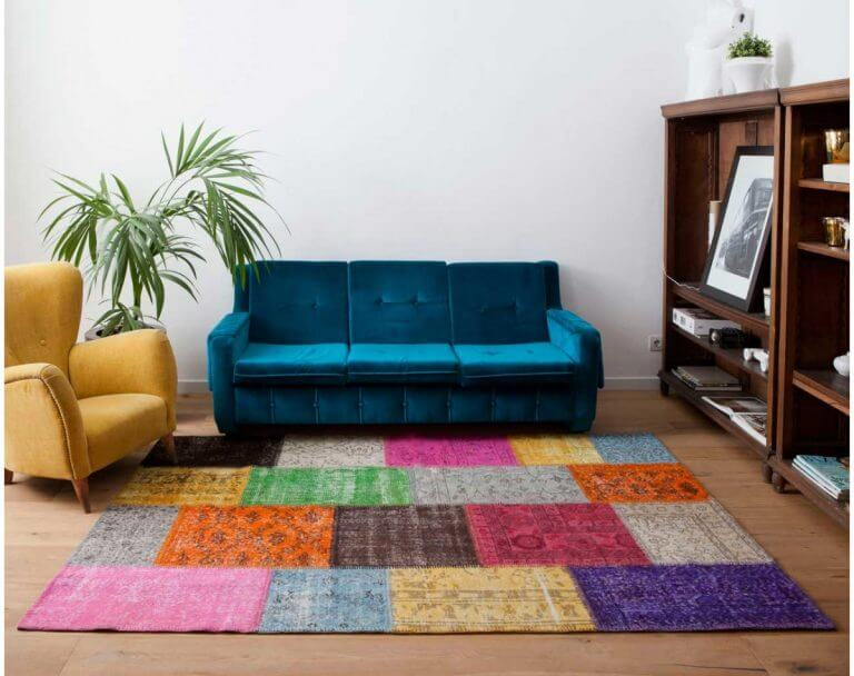 Include a large colorful rug to increase the visual space