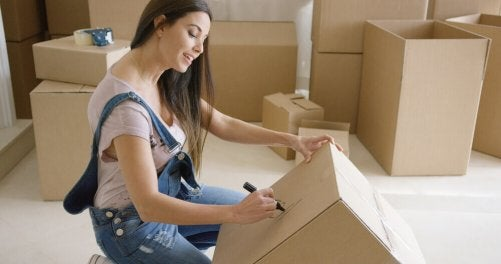 A woman numbering a box not doing this is something to avoid when moving.