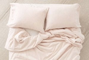 Pastel pink linen bed sheets.