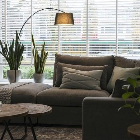 An arc lamp over a sofa.