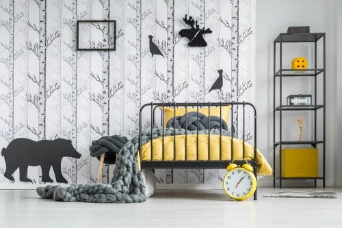 A bedroom decorated in yellow and gray.
