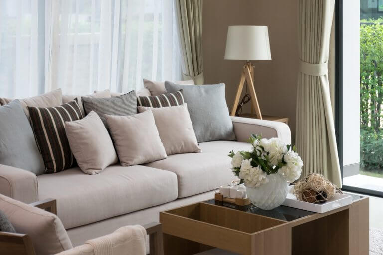 Sofa and lamp with white shade