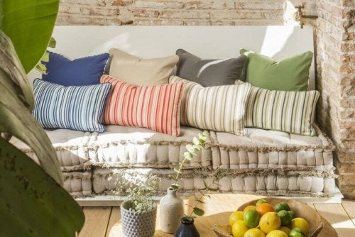 Various colorful cushions on a sofa.
