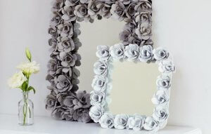 Mirror frames surrounded by flowers