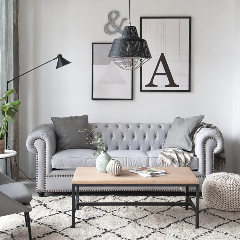 A timber coffee table and a gray Chester sofa