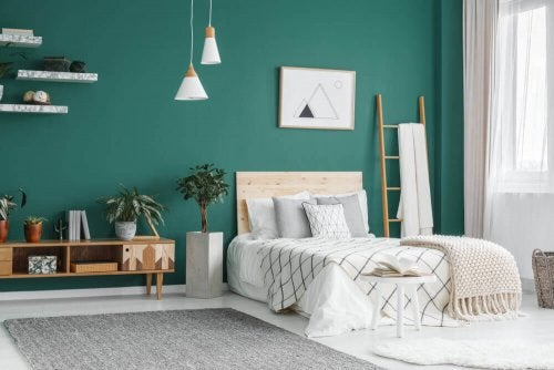 A bedroom with an emerald green wall