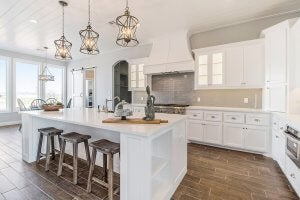 A simply decorated kitchen with white cabinets