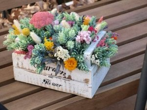 A bunch of flowers in a flower box