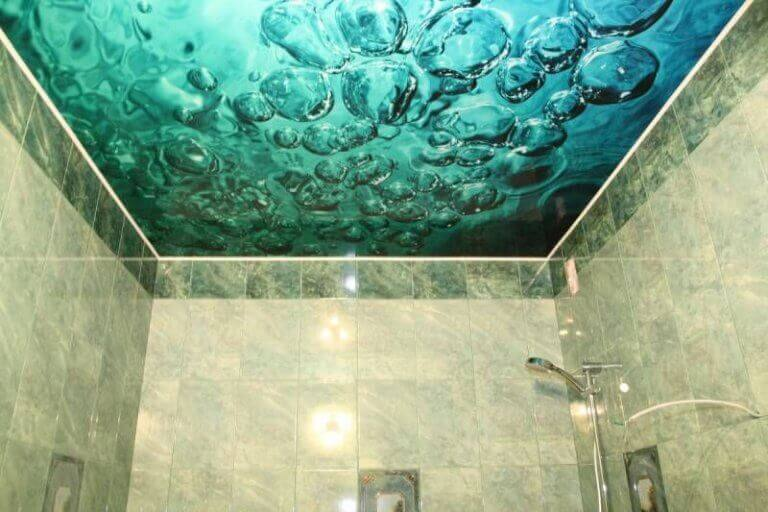 A back lit design of water bubbles above a shower