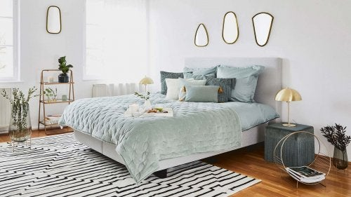 Large bed with aqua linens to update your bedroom