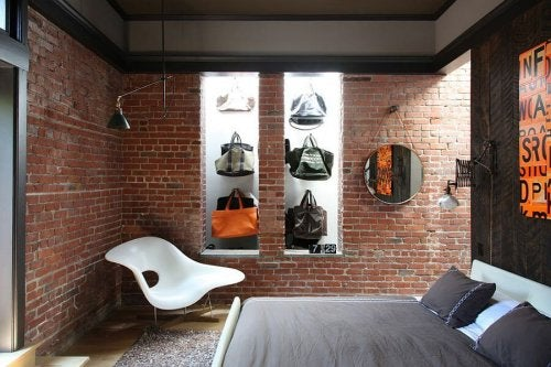 A bedroom with a brick wall.