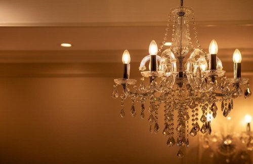 A chandelier hanging from the cealing. This is a great way to get better lighting at home.