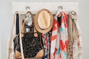 A coat rack can help you organize your articles of clothing.