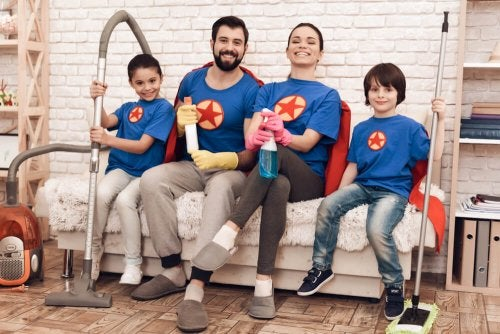 A family of four with good mental health getting ready to clean their home.