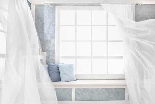 Add fresh, light-colored curtains to the area to make the most of your apartment.