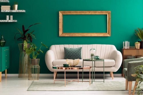 A living room with green and gold accents.