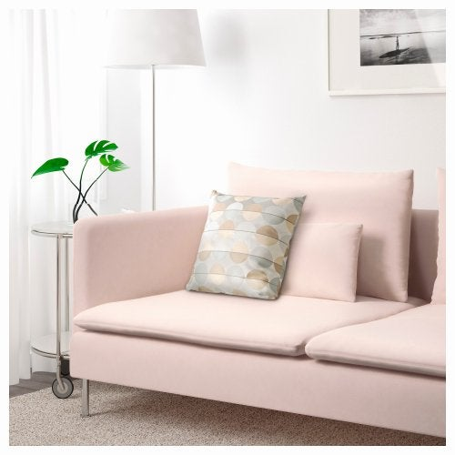 A light-pink couch in a living room.