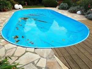 Pool with accumulated dirt on the bottom