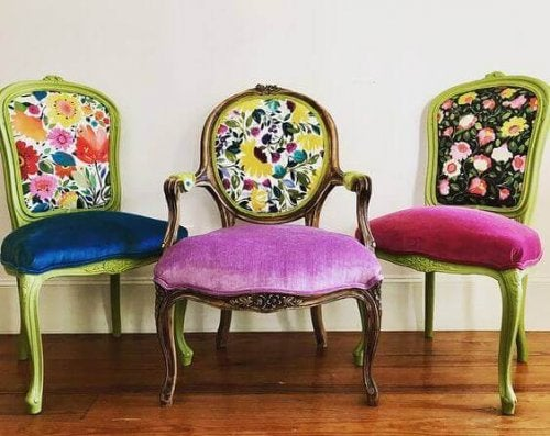 Three chairs with velvet seats and patterned backs