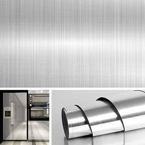 Decorating fridge door with vinyl that looks like stainless steel.