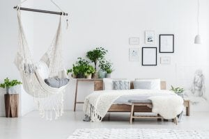 A white bedroom with a hammock.