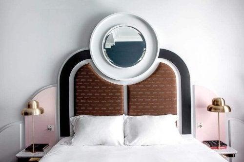 Art deco headboard with a round mirror