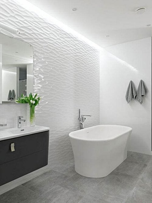 A bright bathroom with tiled walls.