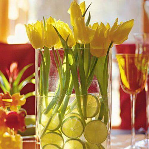 A centerpiece with tulips and lemons.