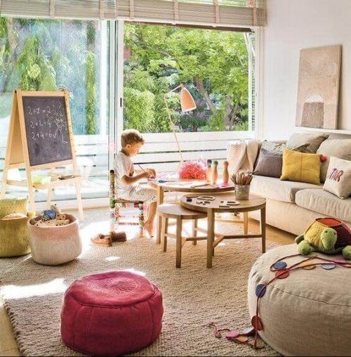 A child in a child's area in a living room.