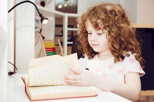 A child reading on a desk.