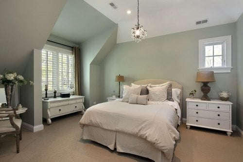 An elegant guest room full of basic accessories.