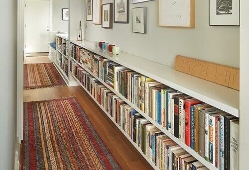 An image of low shelving in a corridor.