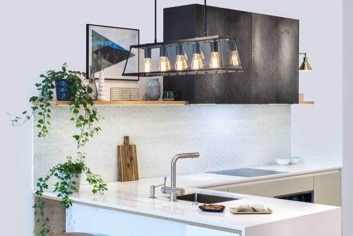 A kitchen illuminated with lightbulbs.