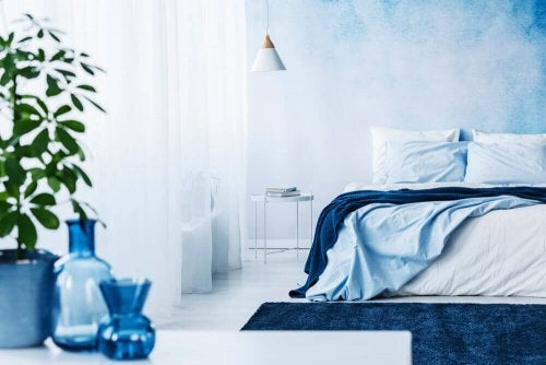 A bedroom featuring different tones of blue.
