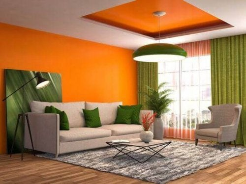 A living room with orange walls.