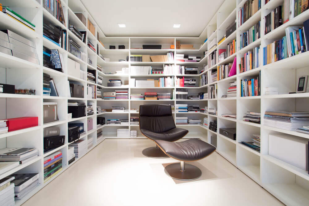 A modern room with lots of books.
