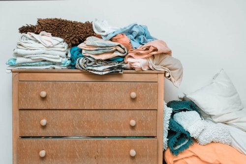 Person organizing a dresser.
