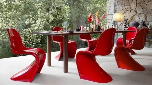 Pop style moded plastic chairs in red