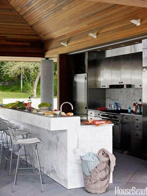 A porch with a full kitchen.